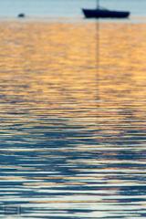 Sailboat Silhouette at Sunrise