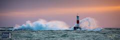 Waves Crash on the Elberta Lighthouse