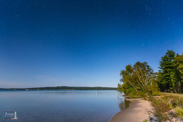 Moonlight photo of stars and Big Dipper over Crystal Lake at Railroad Point.