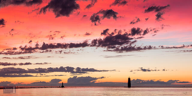 Colorful sunset over Frankfort Harbor and Lake Michigan.