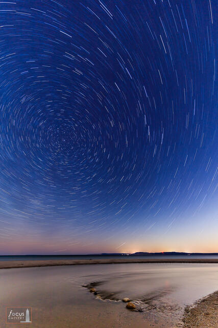 Star trails over Sleeping Bear Dune and Empire Bluffs and Lake Michigan.