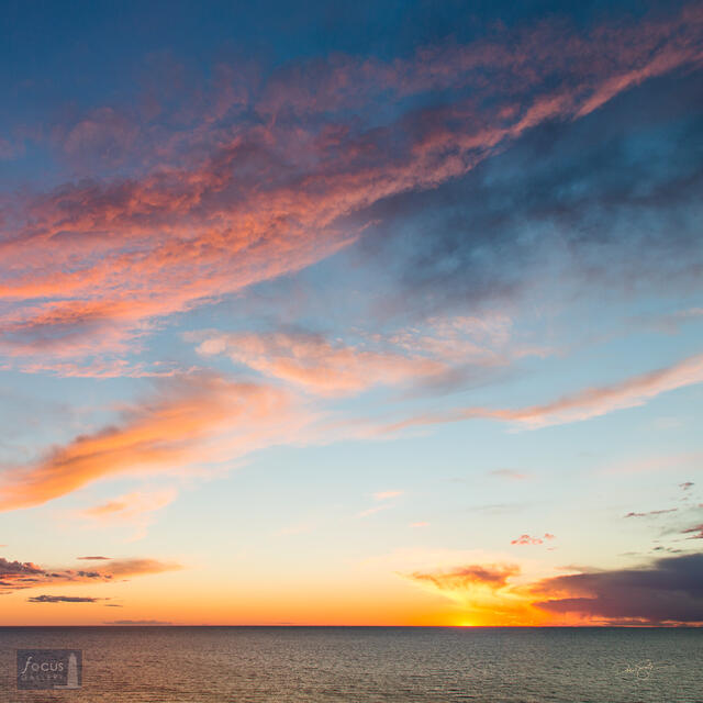 Colorful clouds over Lake Michigan at sunset.