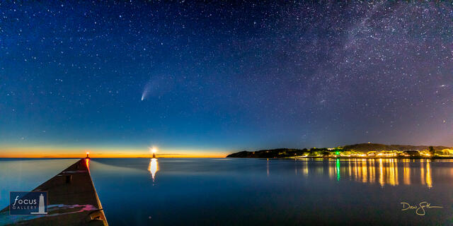 Comet NEOWISE over the Frankfort and Elberta piers with the town of Frankfort and Lake Michigan.