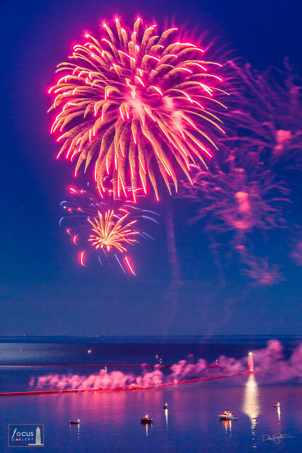 Fireworks explode over the Frankfort harbor on the Fourth of July, Frankfort, Michigan