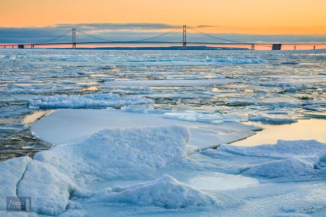 Winter sunrise over frozen Straits of Mackinac and Mackinac Island.