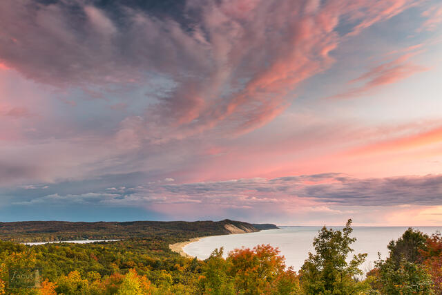 Clouds at sunset over Green Point Dunes, Old Baldy, Lower Herring Lake and Lake Michigan in the fall.