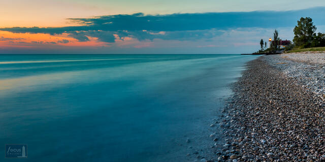 Last colors of sunset at Point Betsie Lighthouse and Lake Michigan shoreline.