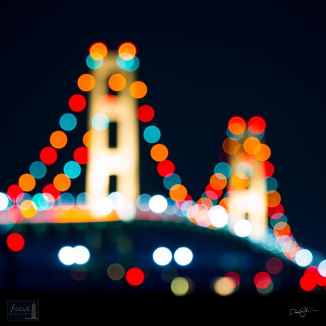 Lights on the Mackinac Bridge at night taken out of focus.
