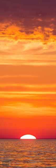 Orange sunset over Lake Michigan.