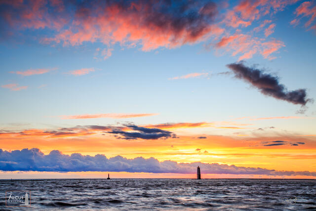 Beautiful and colorful sunset over Frankfort harbor and Lake Michigan.