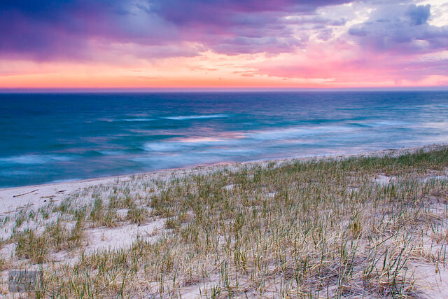 Pastel colored sunset over Lake Michigan at Grace Road Beach, Elberta, Michigan.