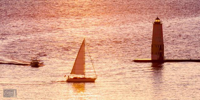 Sailboat and fishing boat in Frankfort harbor, Lake Michigan.