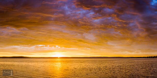 Dramatic sunrise over Platte Lake in Benzie County, Michigan.