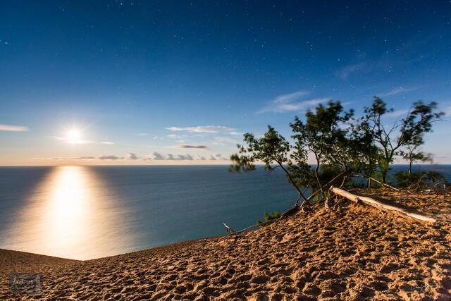Moonset over Lake Michigan from Sleeping Bear Dune where moon looks like the sun.