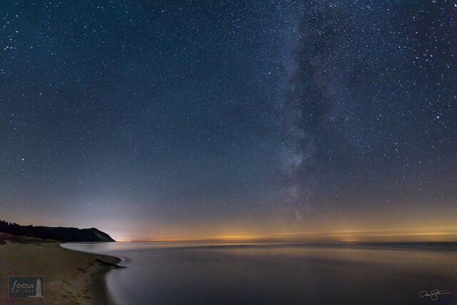Stars and Milky Way over Lake Michigan and Old Baldy, Benzie County, Michigan.