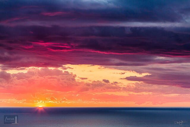 Colorful cloudy sunset over Lake Michigan.