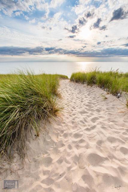 Sandy pathway through dunes to shore of Lake Michigan.
