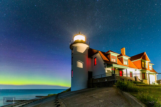 Aurora borealis over Lake Michigan and the Point Betsie Lighthouse.