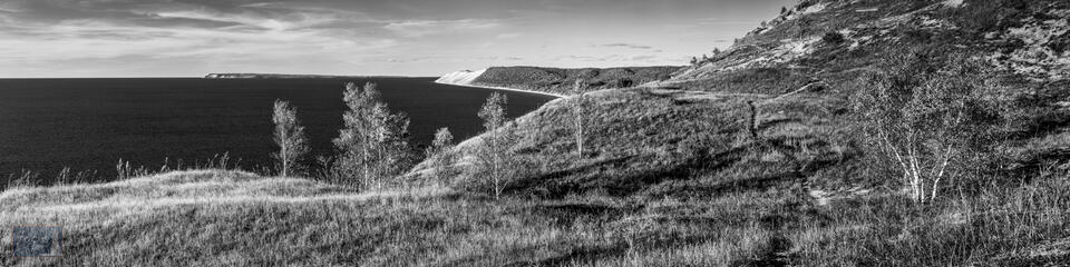 Black and white photograph of a trail through dunes in Sleeping Bear Dunes National Lakeshore.