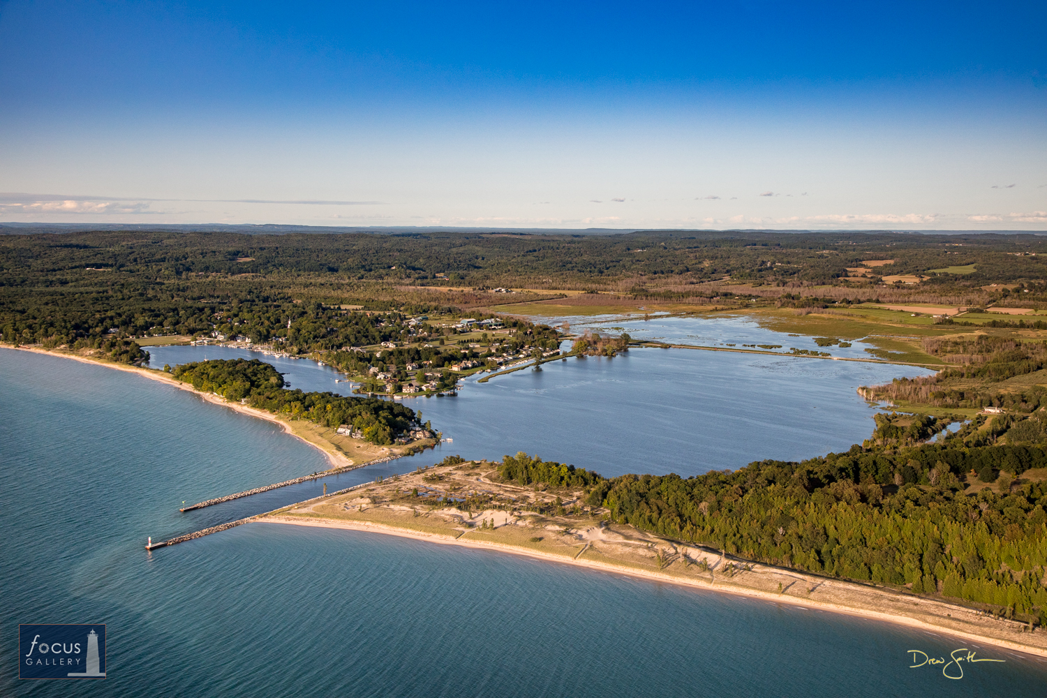 Photo © Drew Smith View of Arcadia, Arcadia Lake and the outlet to Lake Michigan in Manistee County.