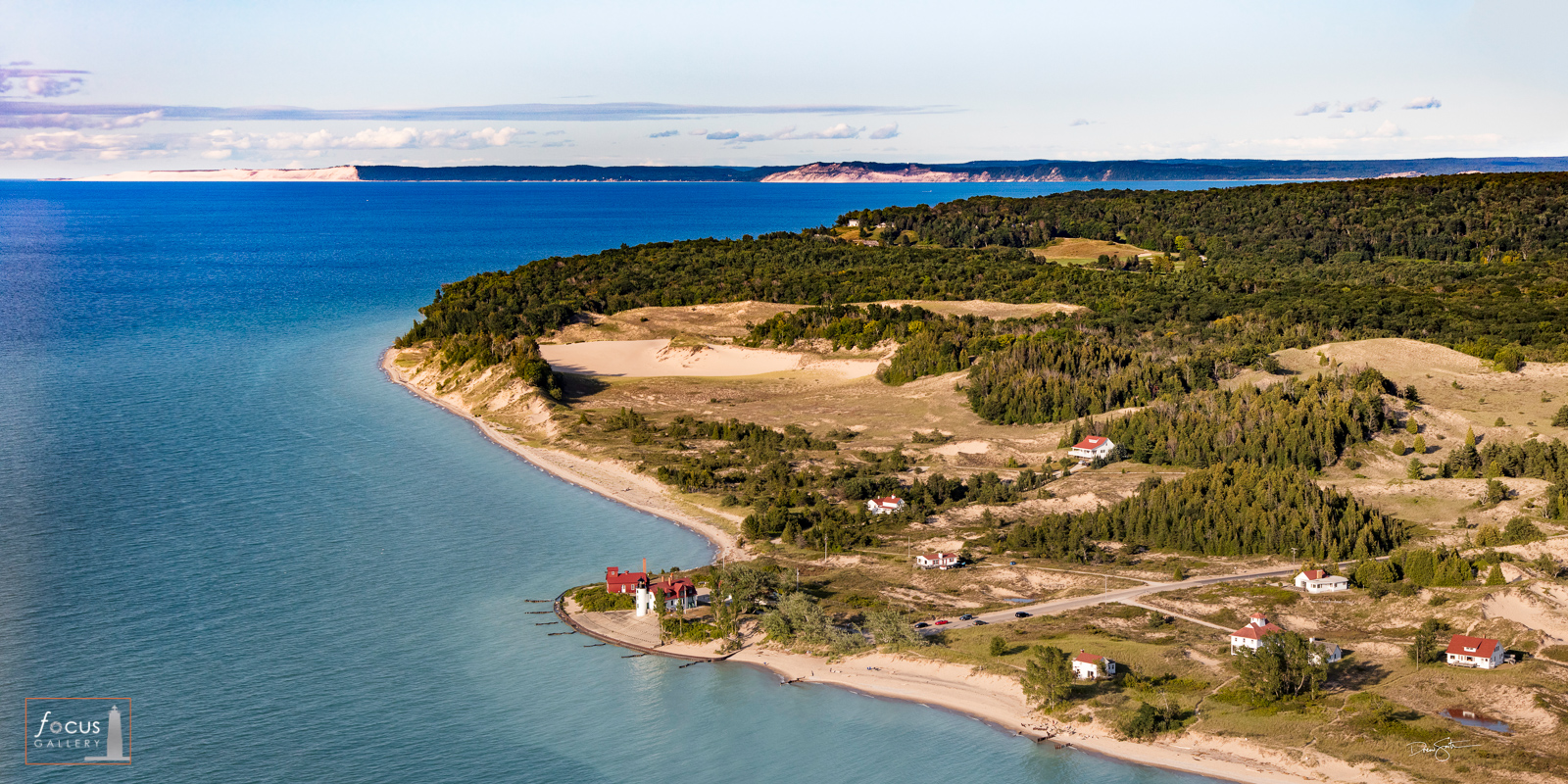 Aerial view of Point Betsie Lighthouse, Empire Bluffs and Sleeping Bear Dune over Lake Michigan.