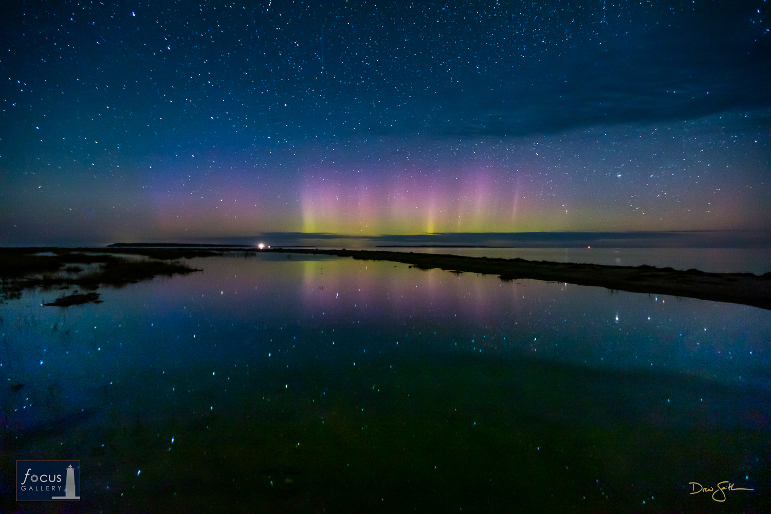 Photo © Drew Smith A sky full of stars, northern lights, the South Manitou Lighthouse, and a perfectly still lakeshore pond...