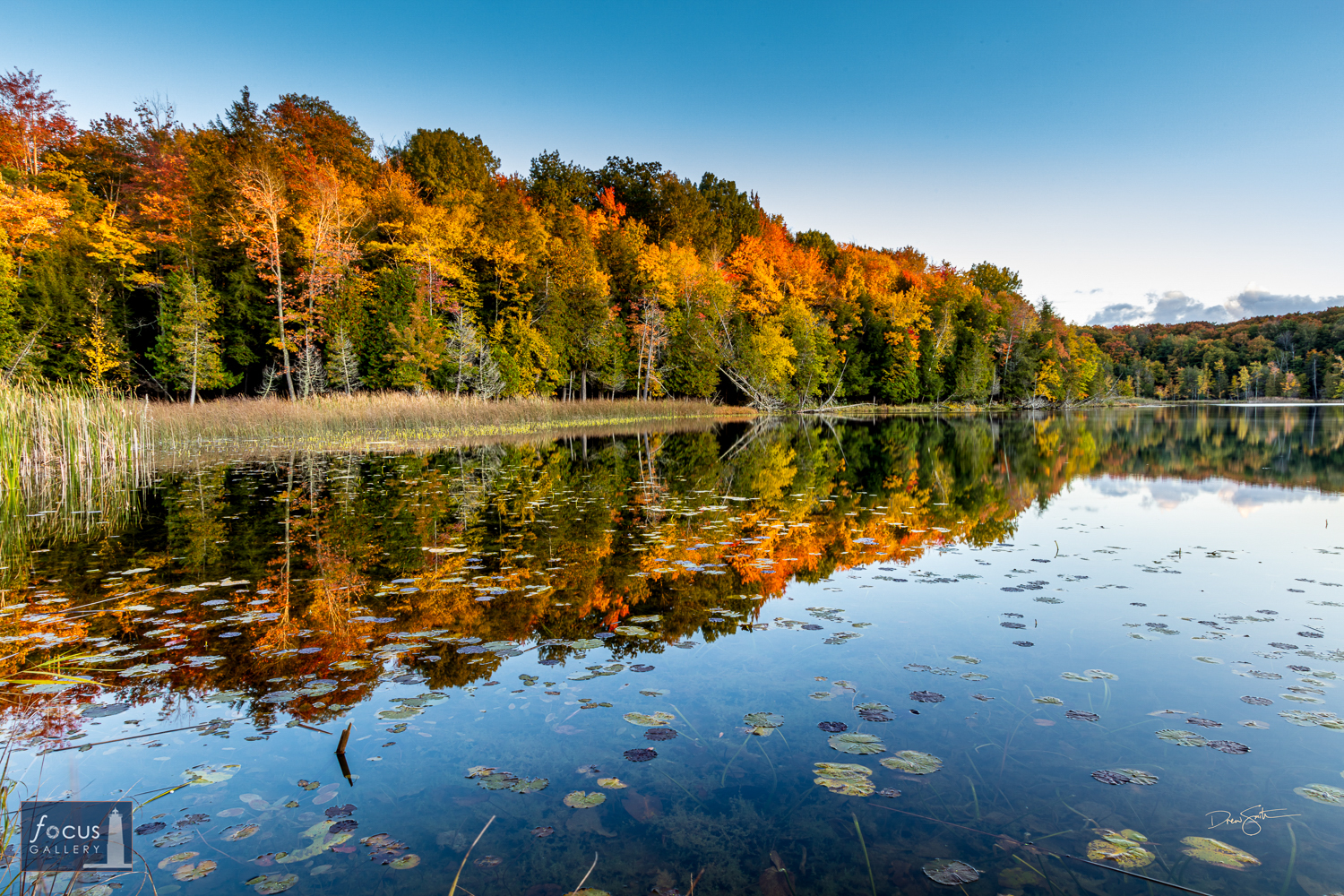 Photo © Drew Smith Colors of fall are reflected on the calm surface of Lower Woodcock Lake at nightfall. This image was taken...