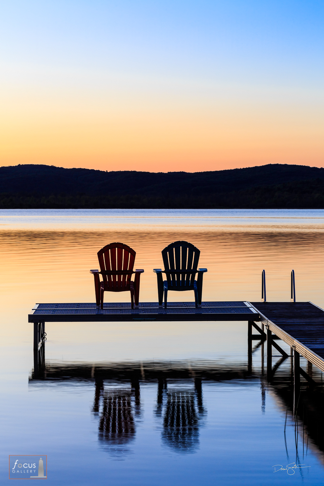 Two Adirondack Chairs on a dock at Sunset, Benzie County, Michigan