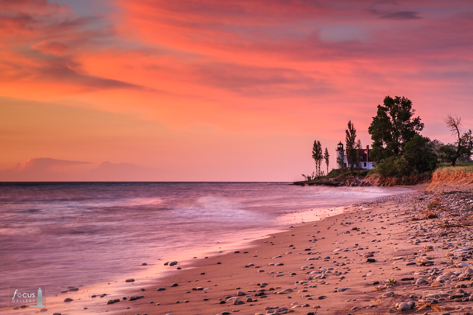Colorful sunset at Point Betsie Lighthouse on the shore of Lake Michigan, Point Betsie, Benzie County, Michigan.