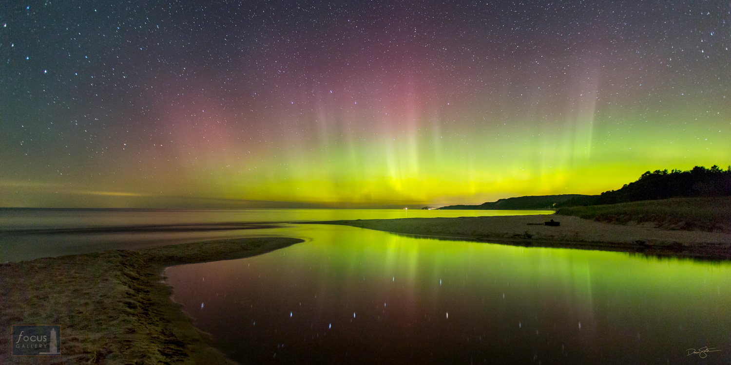 Big Dipper and its reflection with aurora borealis at Herring Creek Outlet, Lake Michigan, Benzie County, Michigan.