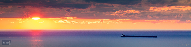 Laker freighter on Lake Michigan at sunset.