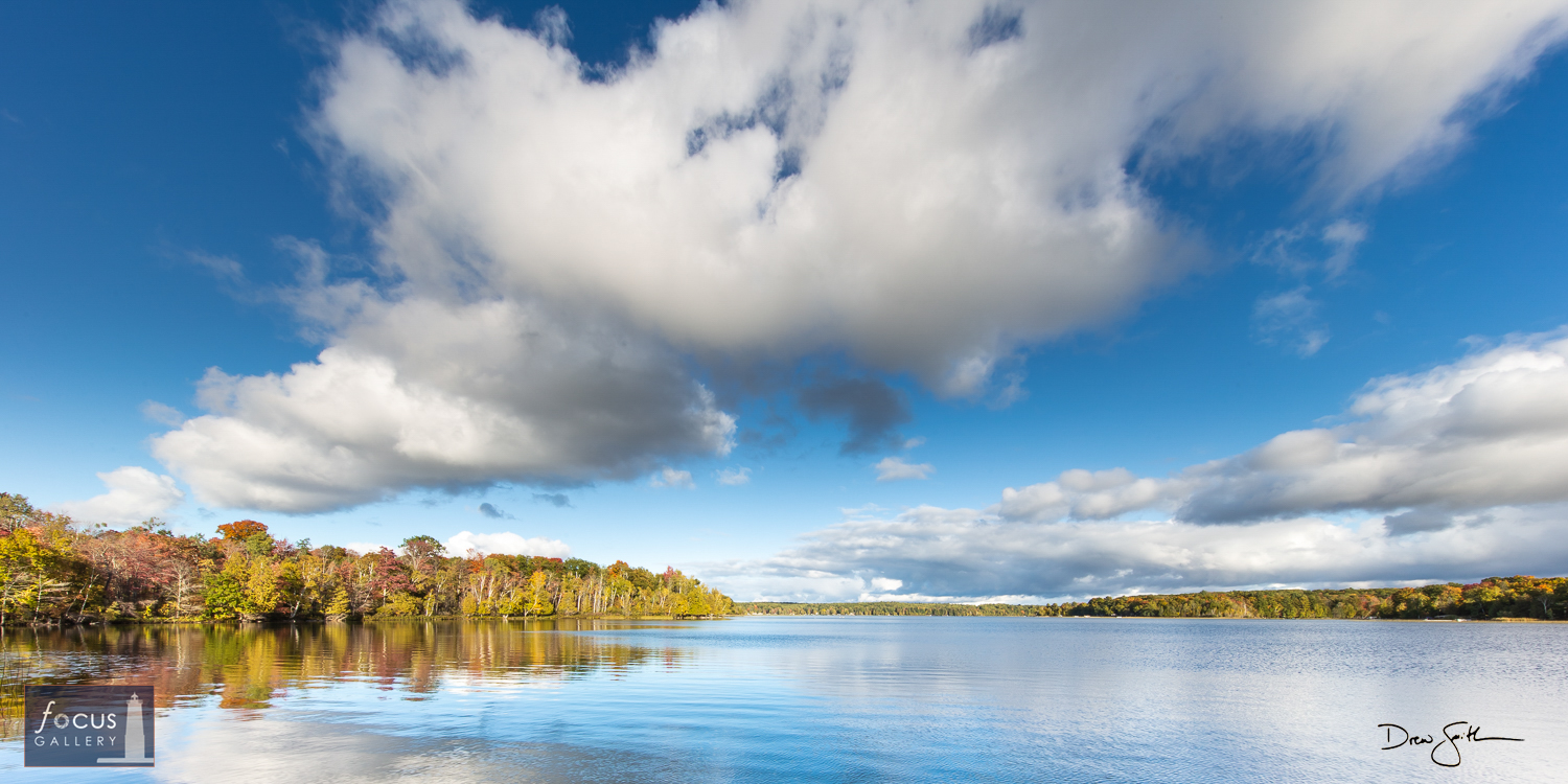 Photo © Drew Smith Beautiful clouds float through blue skies over Lake Ann on a gorgeous autumn afternoon.