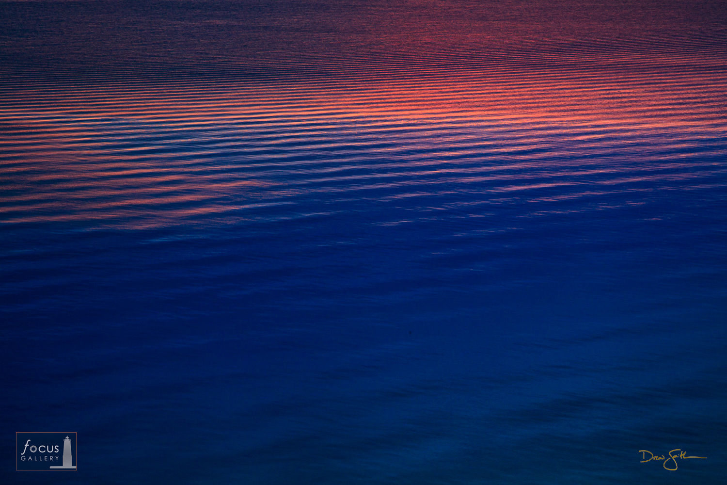 Photo © Drew Smith Waves on Lake Michigan reflect the dusk glow in the sky and appear like ripples on the water.