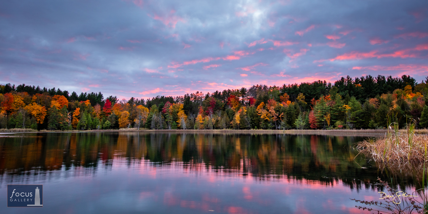 Photo © Drew Smith The last light of sunset hits the bottoms of the clouds over Lower Woodcock Lake on a peaceful autumn evening...