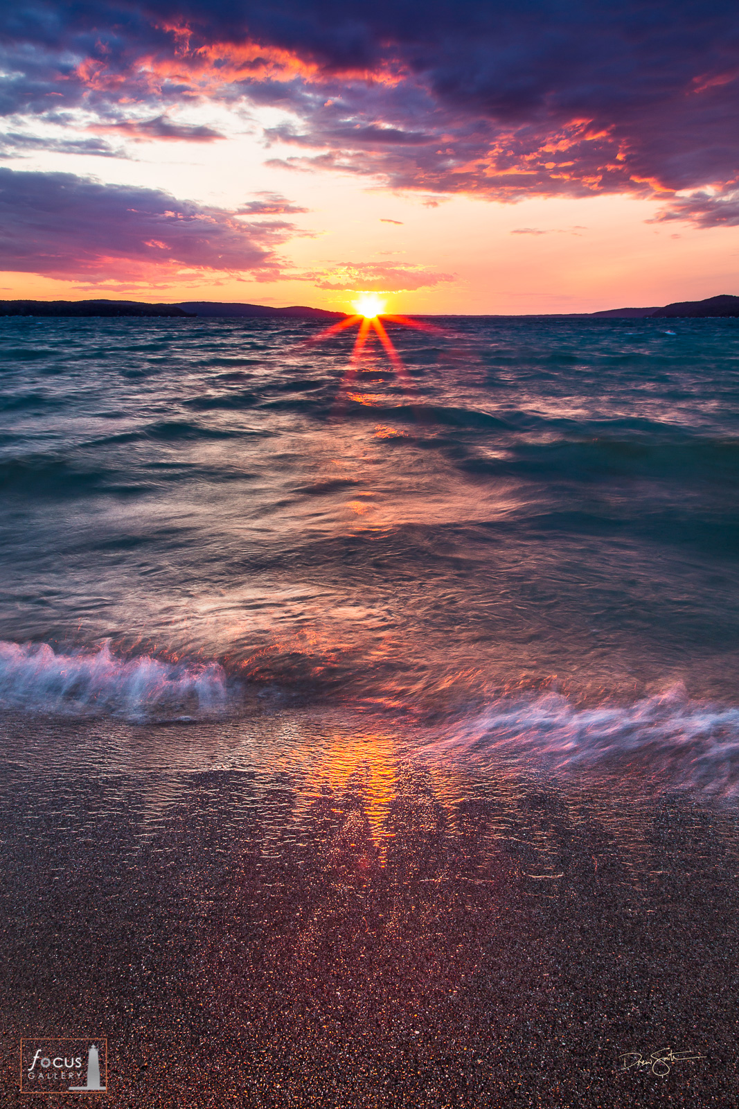 Colorful sunset over a wavy Crystal Lake.