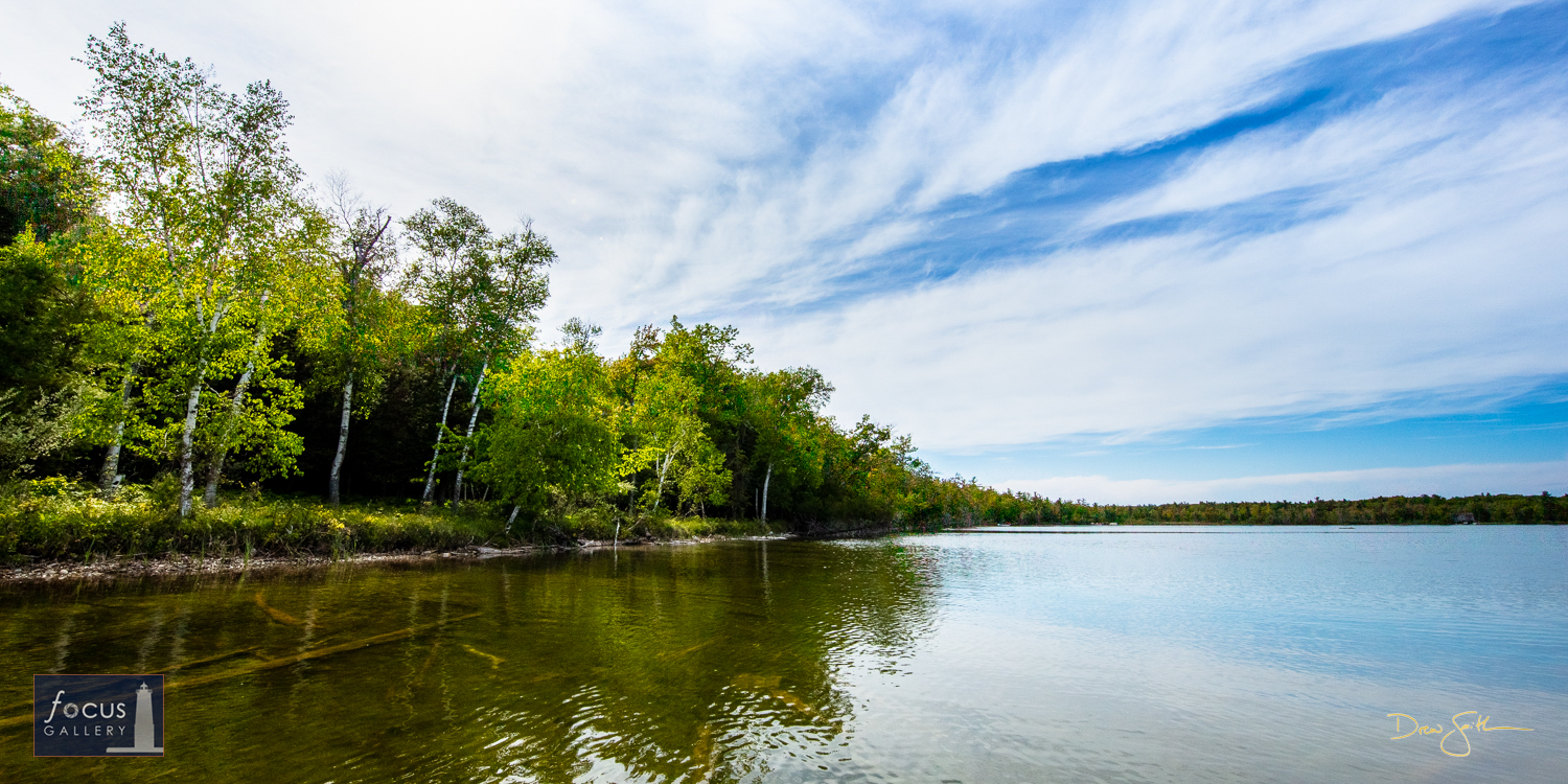 Photo © Drew Smith View of the Little Platte Lake shoreline at Mount Minnie on a spring afternoon. This image was taken on land...