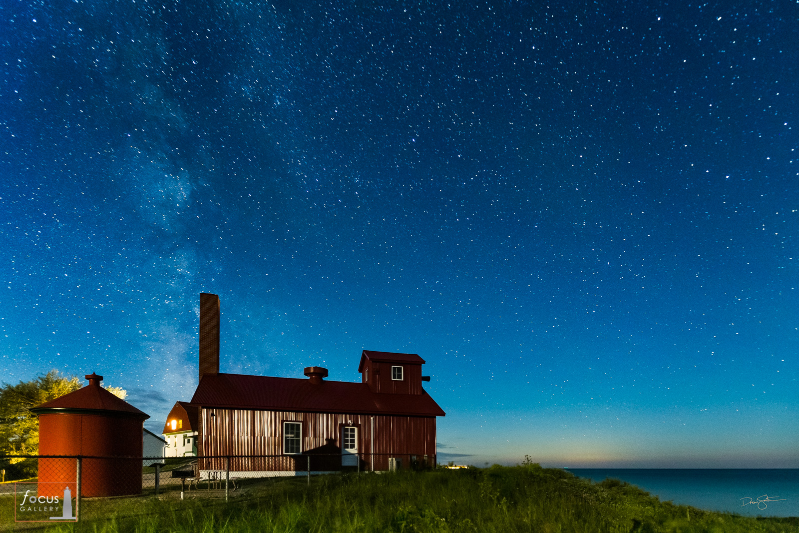 Starry skies over the fog signal building at the Point Betsie Lighthouse in Benzie County, Michigan.