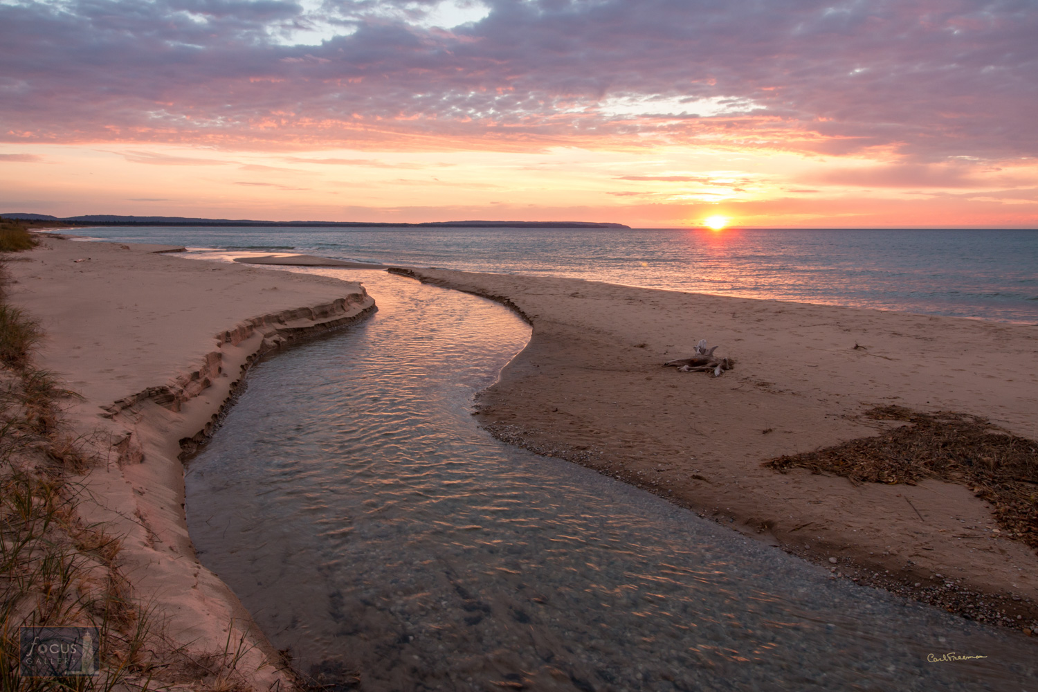 Photo © Carl Freeman Small creeks that flow into Lake Michigan change course frequently and can get dammed up by sifting sands...