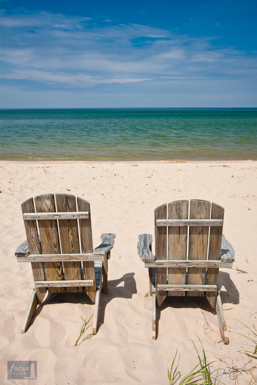 Summer is all about taking it easy and making great memories.  These chairs on the shore of Lake Michigan are just the right...