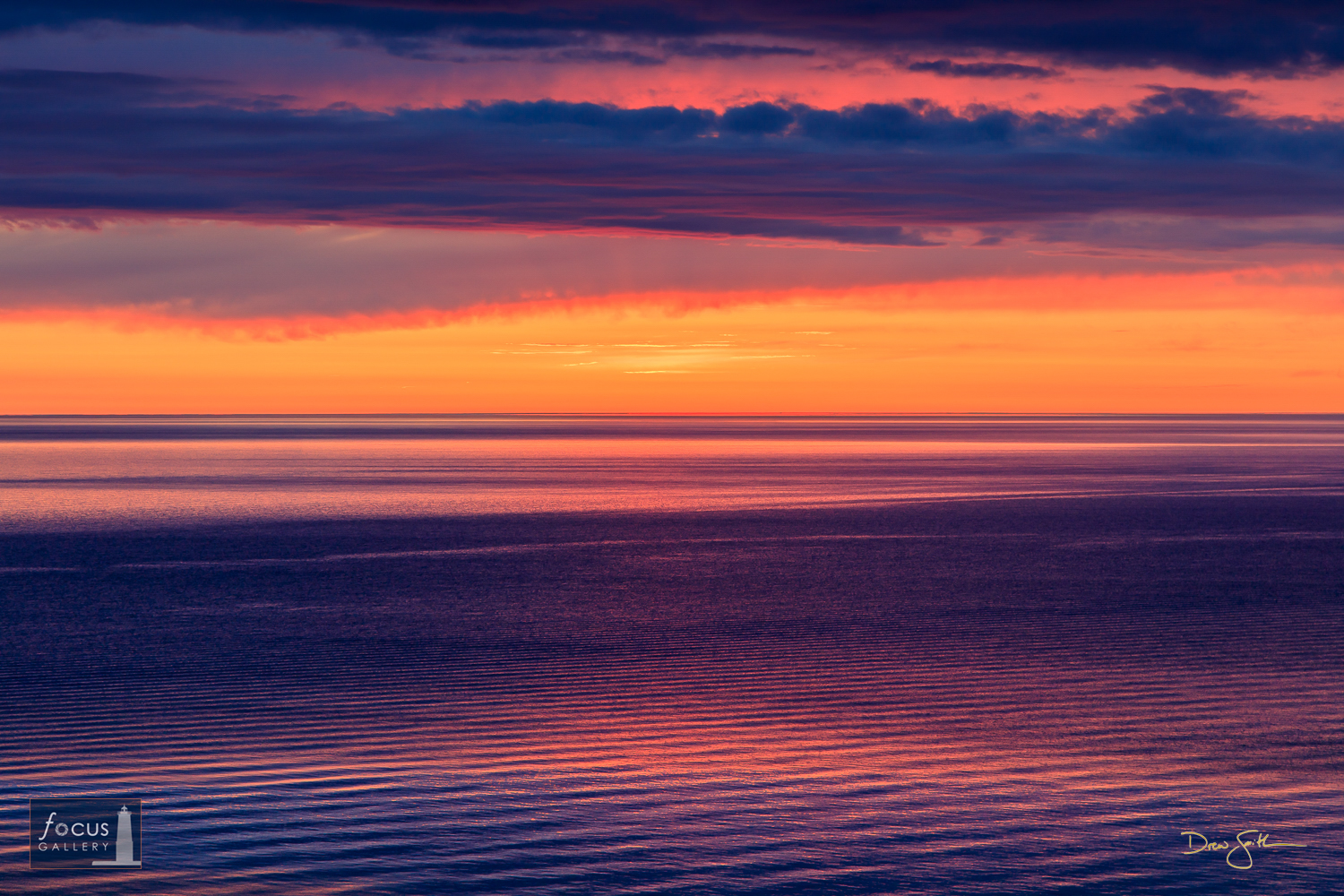 Photo © Drew Smith The post-sunset glow creates layers and layers of texture and color in the clouds and surface of Lake Michigan...