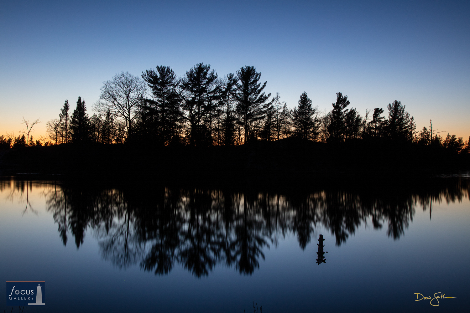 Photo © Drew Smith Trees along the banks of the Platte River are silhouetted against the last light of day near Platte River...