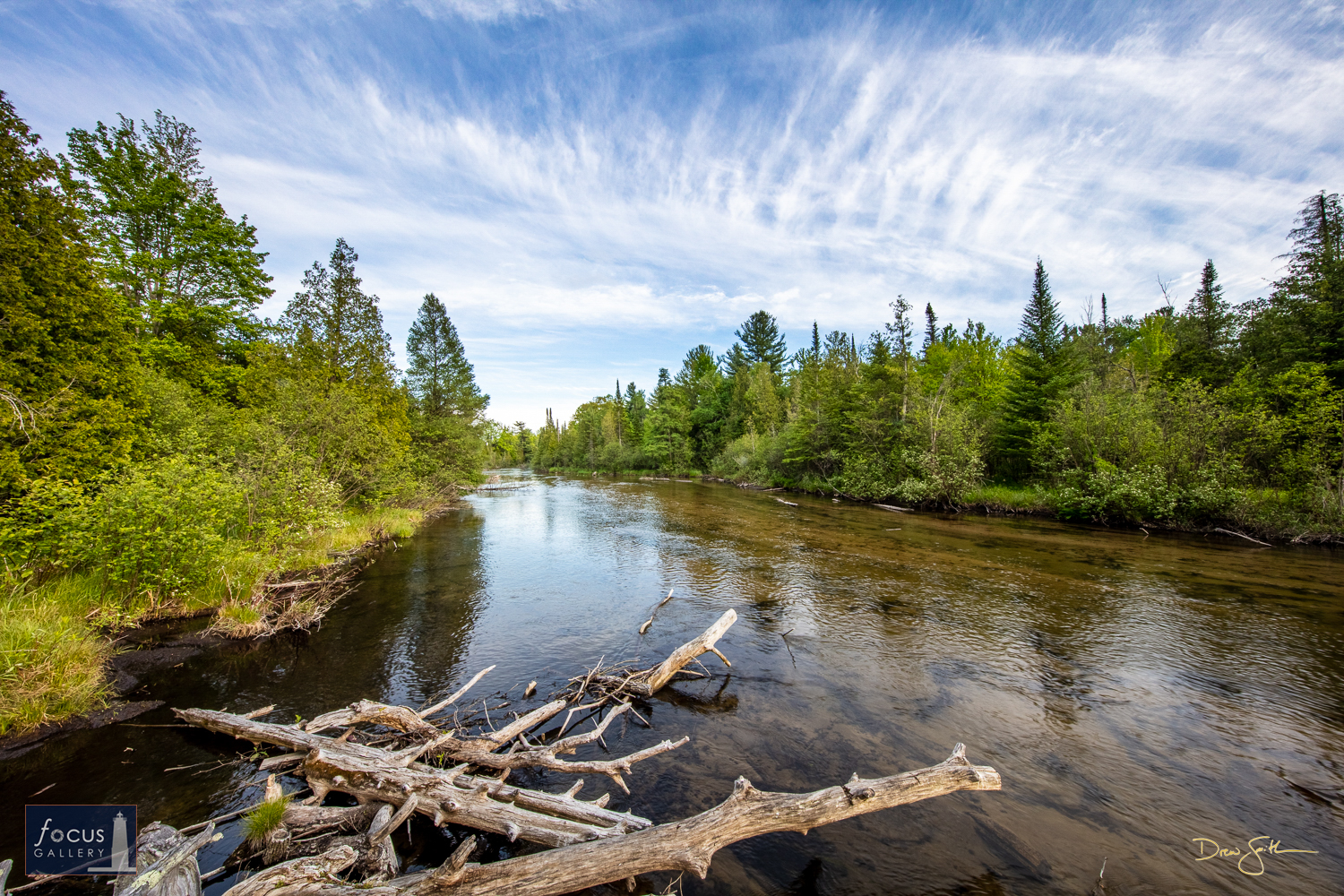 Photo © Drew Smith Blue skies and cirrus clouds hang above the Platte River on a beautiful late spring afternoon. This image...