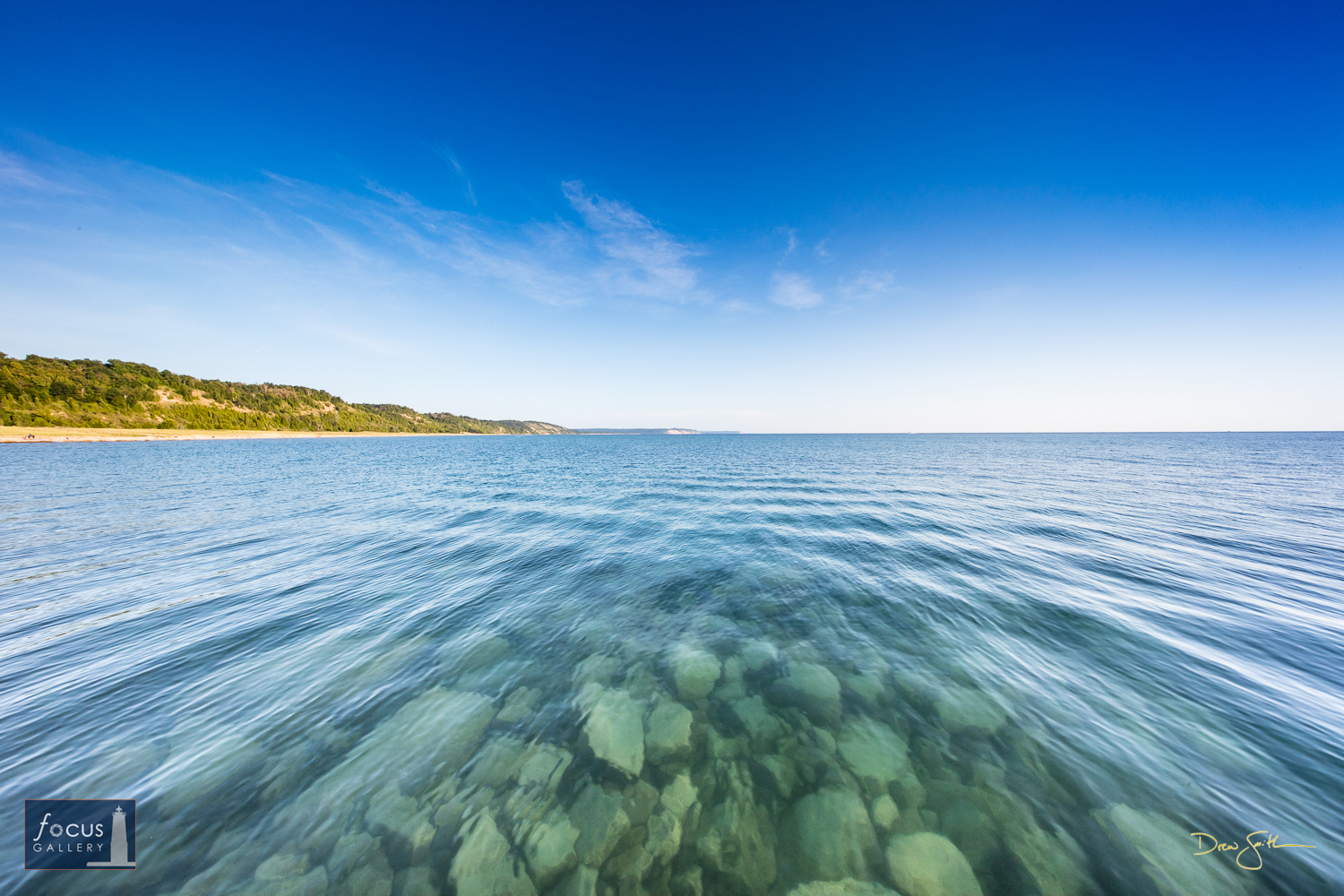 Photo © Drew Smith Looking South from the Elberta pier with a view of the rocks along the breakwater on Lake Michigan and the...