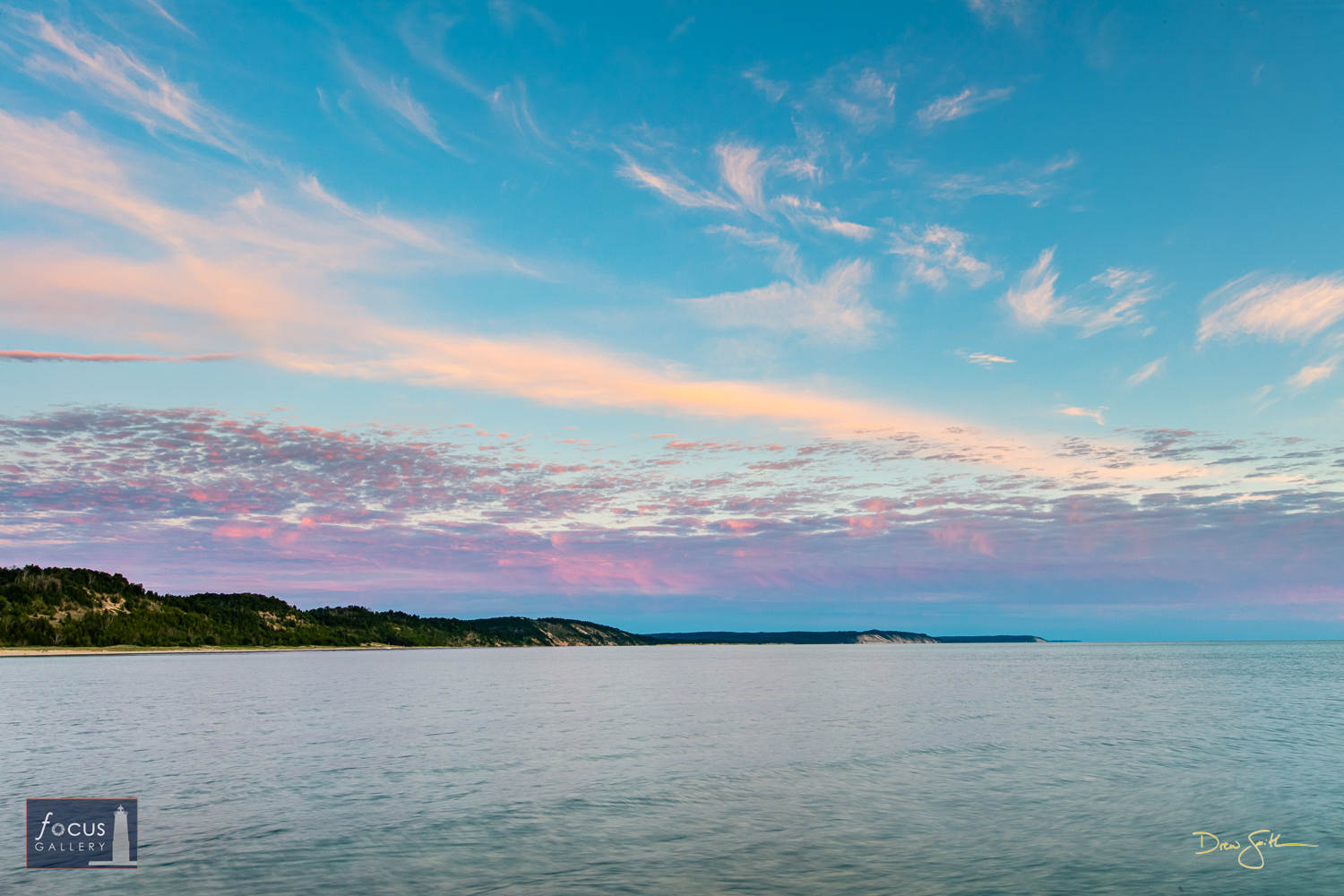 Photo © Drew Smith Layers of clouds glow with the last colors of the sunset over the Elberta, Green Point and Arcadia dunes...