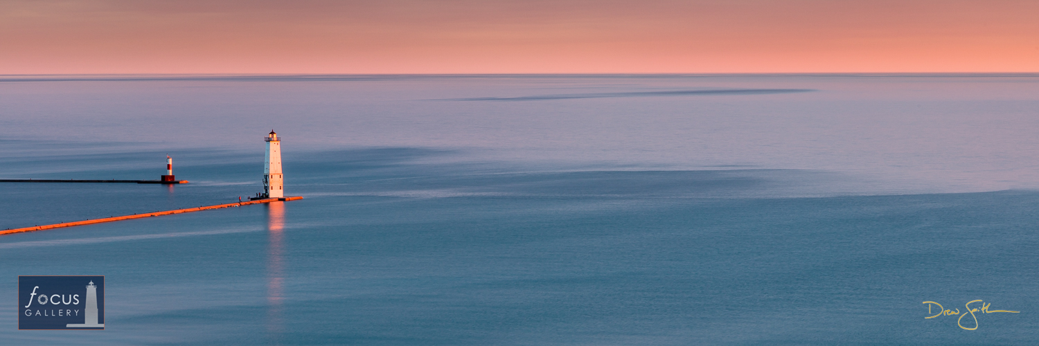 Photo © Drew Smith A soft pastel sunset palette over the Frankfort and Elberta piers and a calm Lake Michigan - what a beautiful...