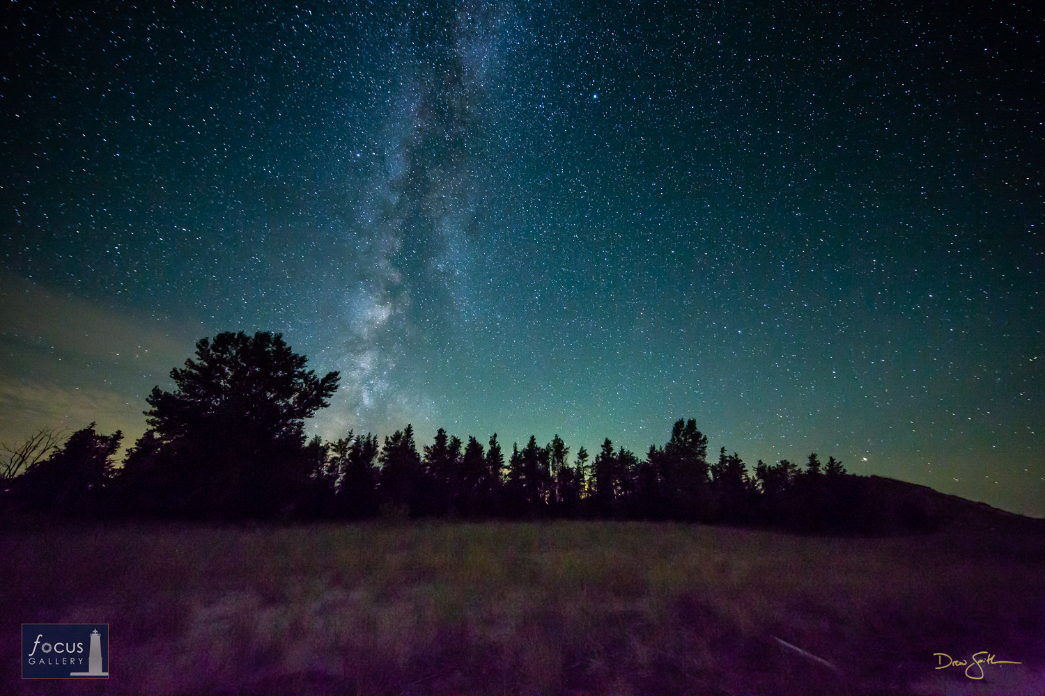 Photo © Drew Smith A sky full of stars and the Milky Way shine over the wooded dunes at Glen Haven on Sleeping Bear Point....