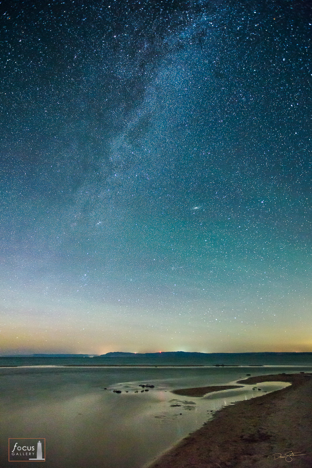 Starry skies and the Milky Way over Lake Michigan and the Platte River at Platte Point, Sleeping Bear Dunes, Michigan.