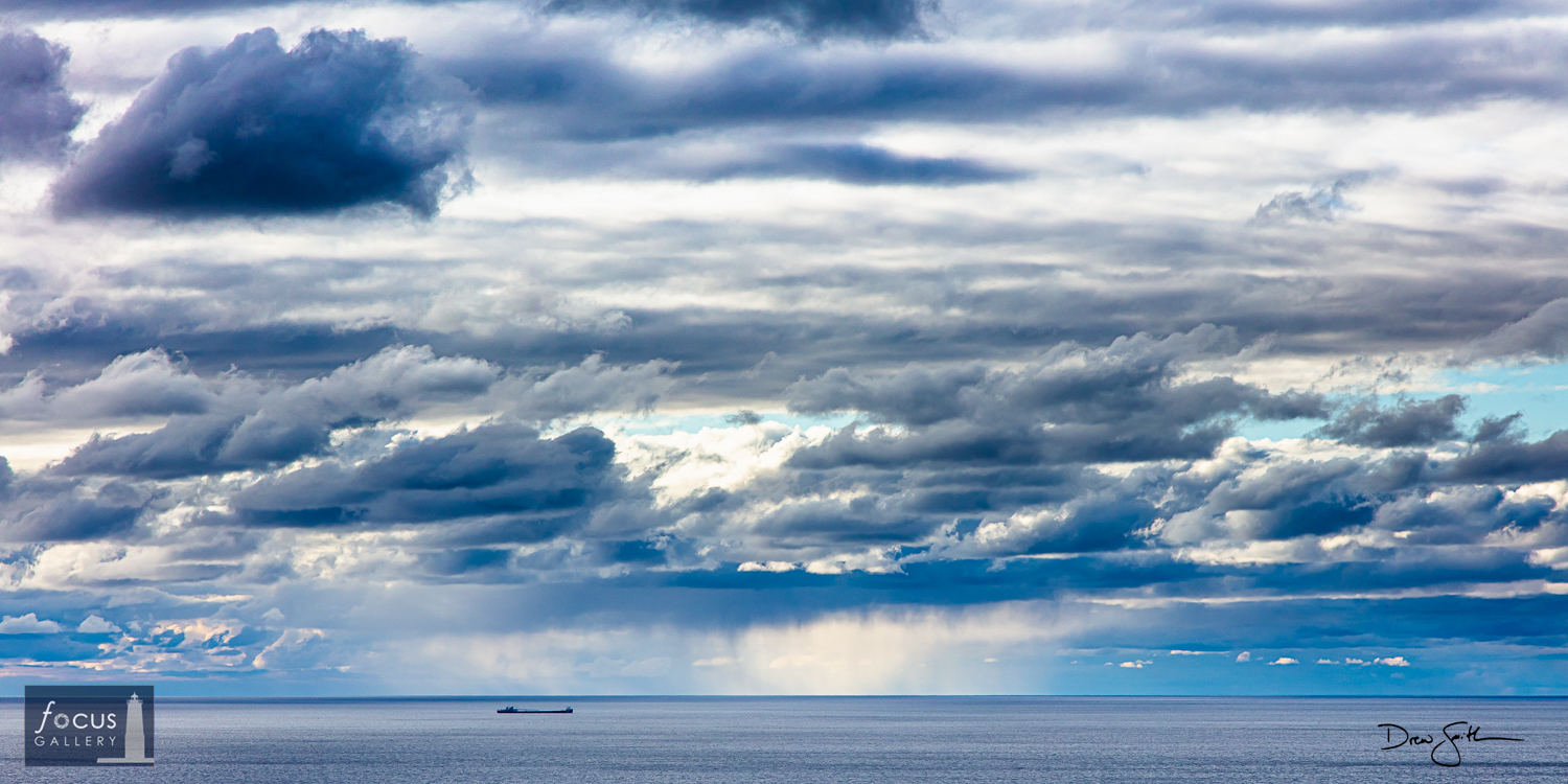 Photo © Drew Smith A laker passes through stormy weather on Lake Michigan.  This photo was taken from atop the Empire Bluff...