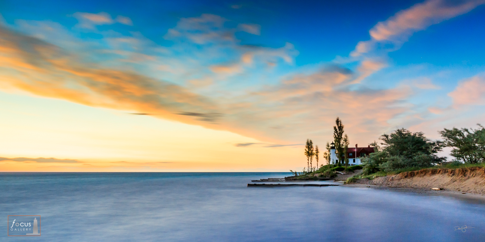 Sunset colors over Lake Michigan and Point Betsie Lighthouse.