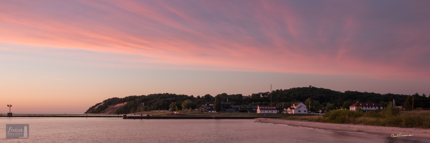 Photo © Carl Freeman Taken from the Elberta Pier looking toward the coast guard station and Frankfort.